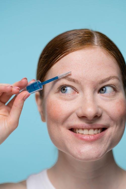 Woman Holding Blue Ballpoint Pen