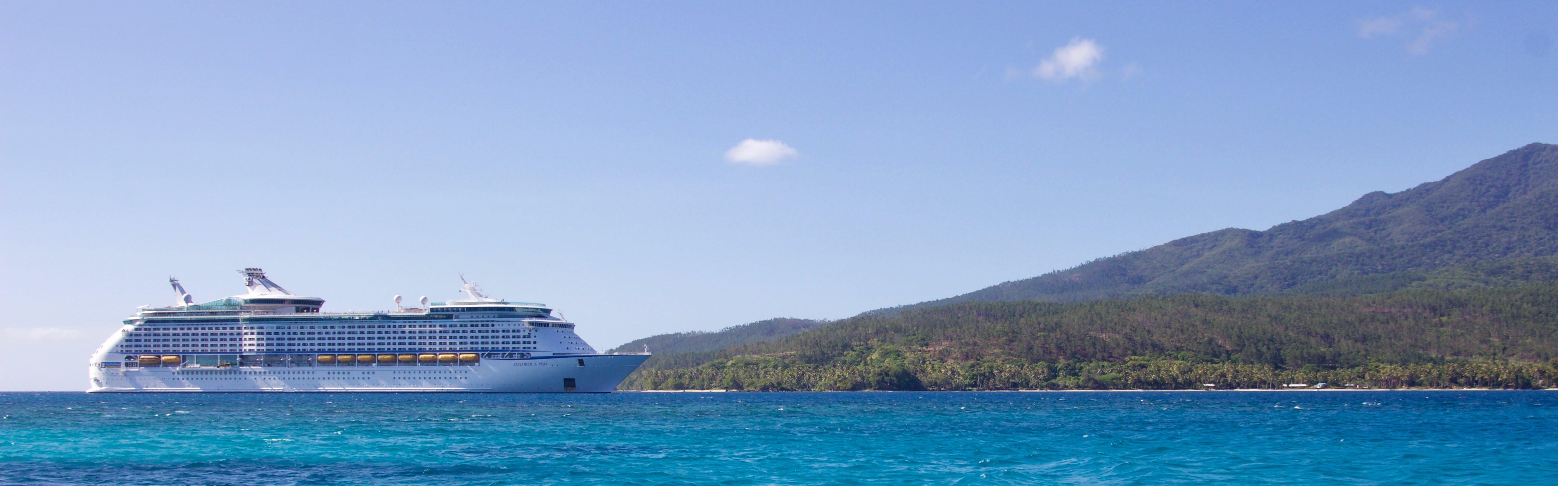 White Cruise Ship Near Island