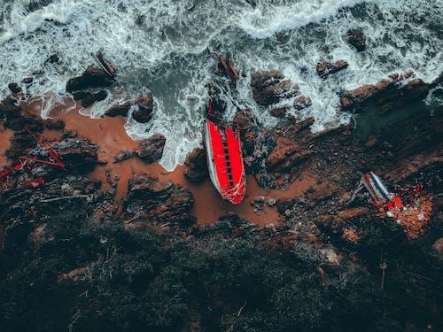 Water Waves Hitting Brown Rocks