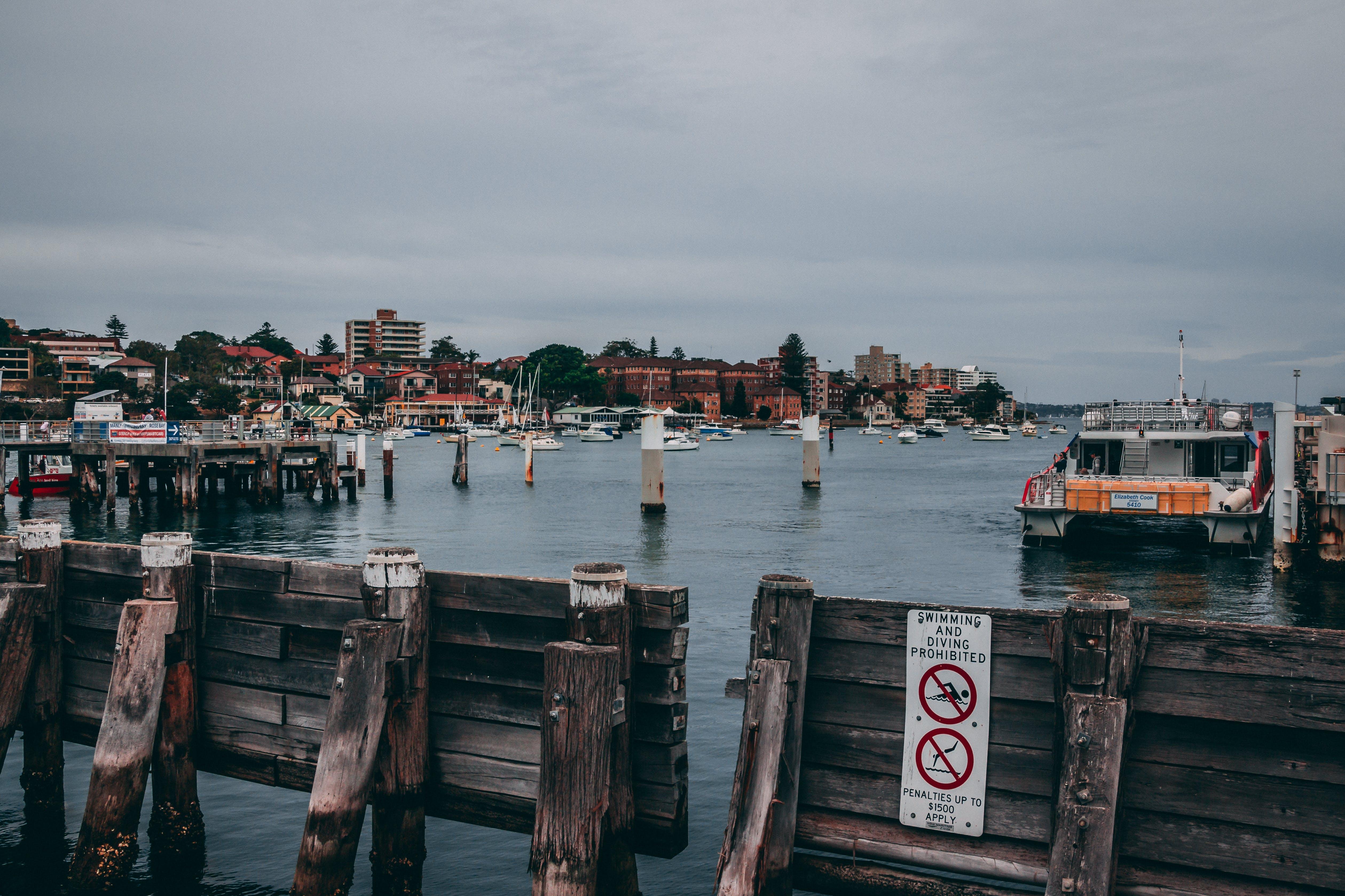 Boat Beside Dock Near Gray Post