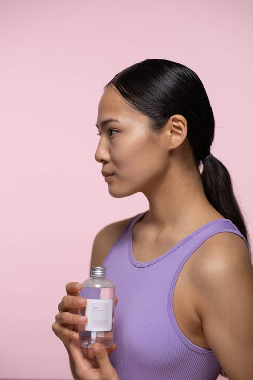 Woman Holding A Bottle Of Tonic