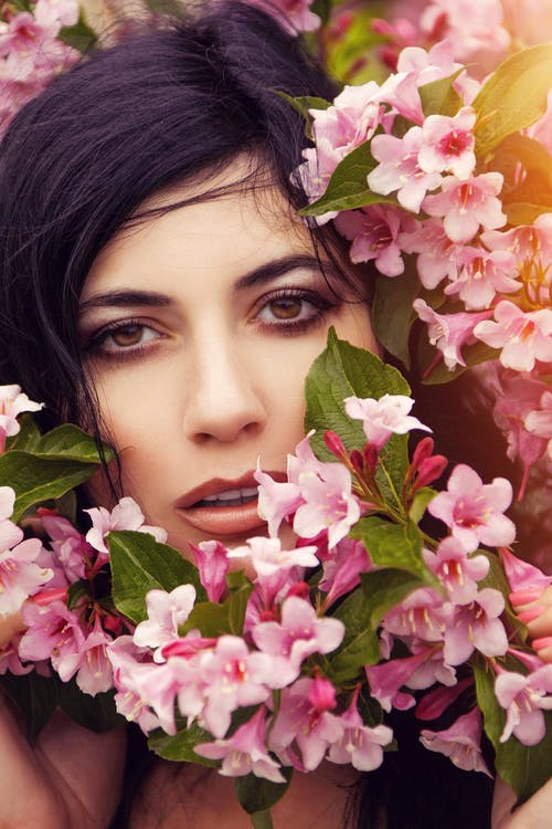 Woman With Pink and White Flowers on Her Head