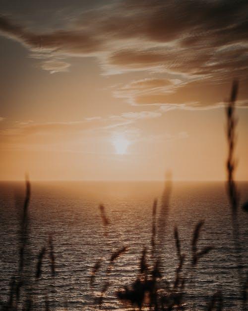 Sunset sky over rippling sea
