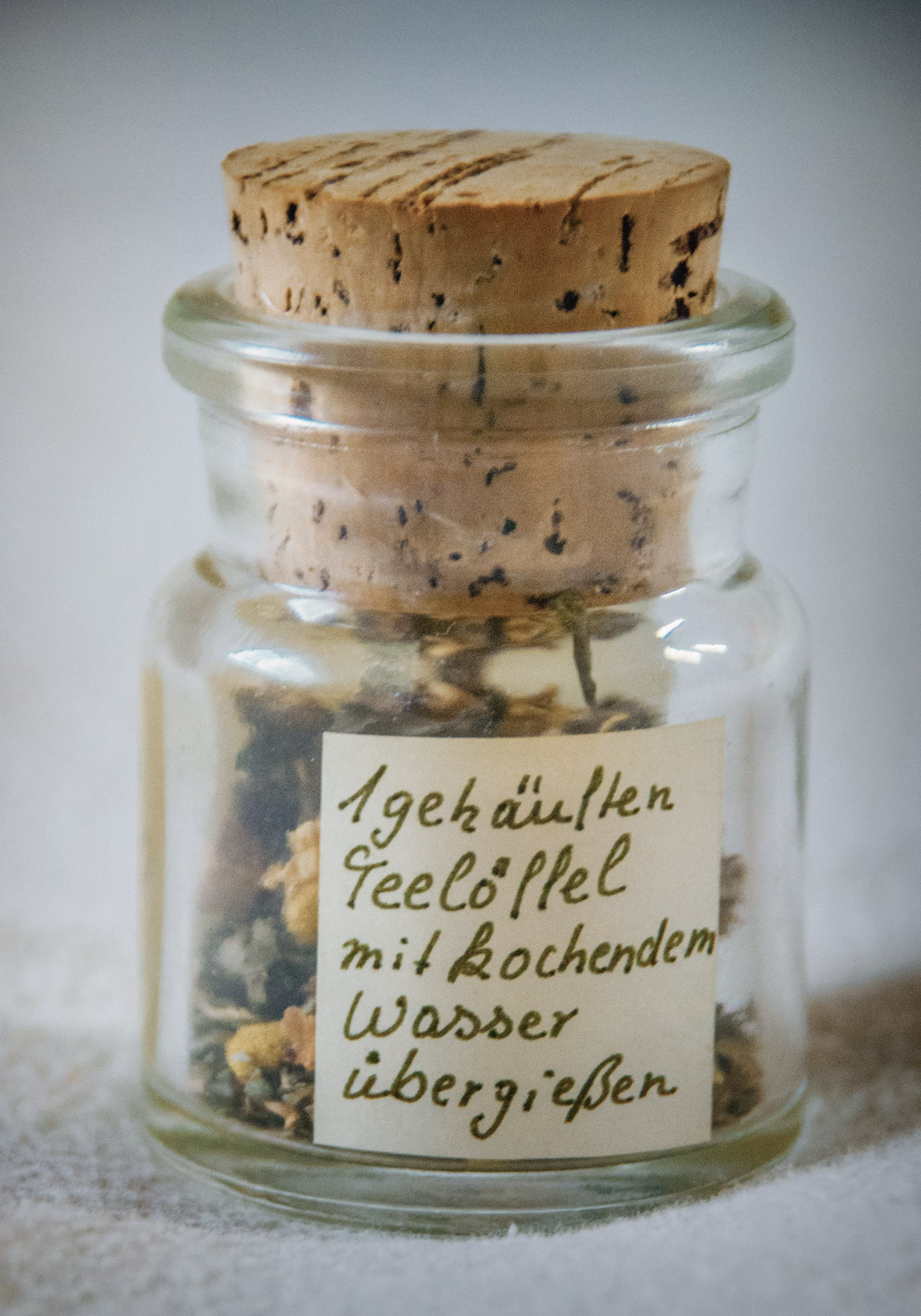 Paper Inside Clear Glass Jar With Brown Cork