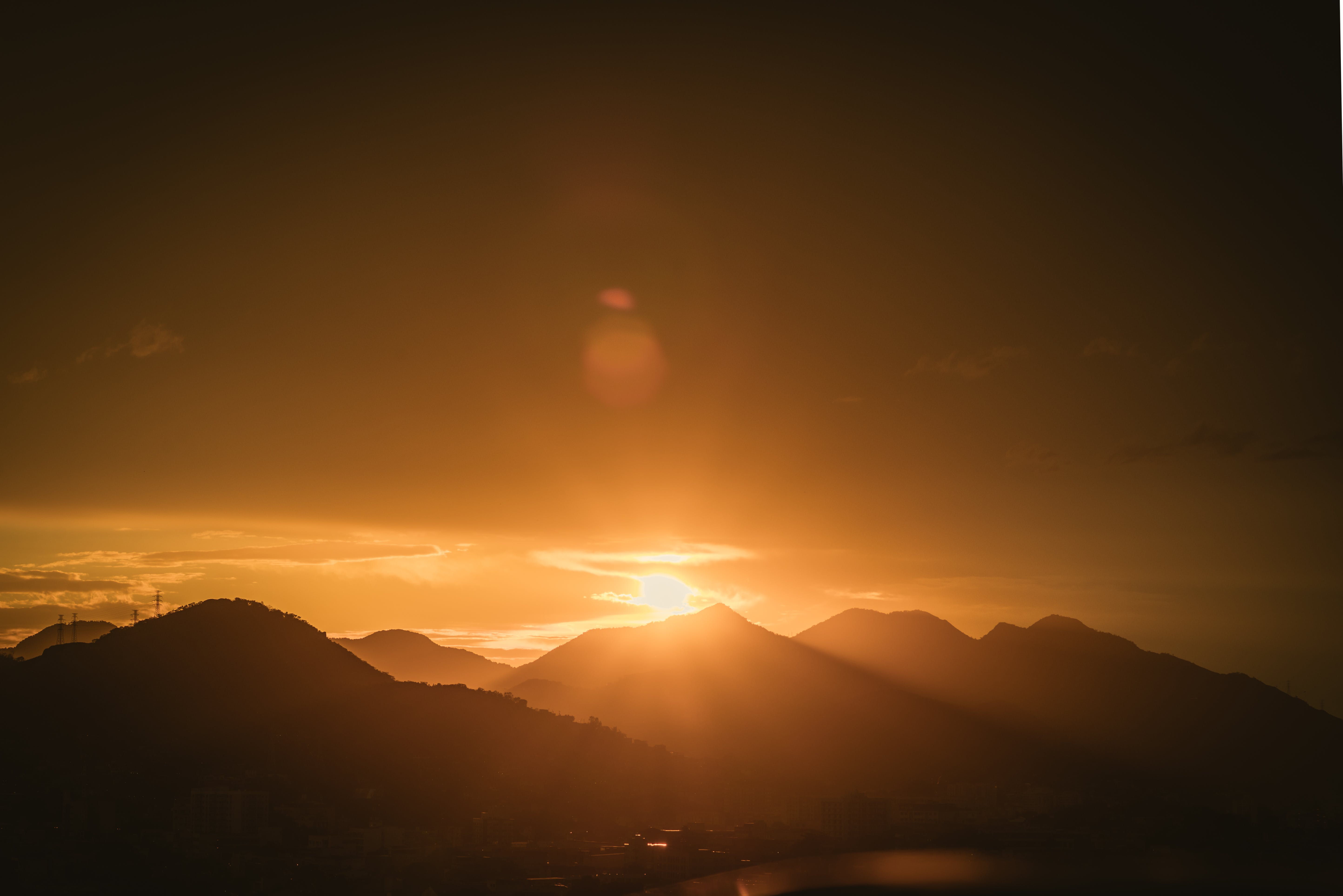 Silhouette Photo of Mountain Range during Golden Hour