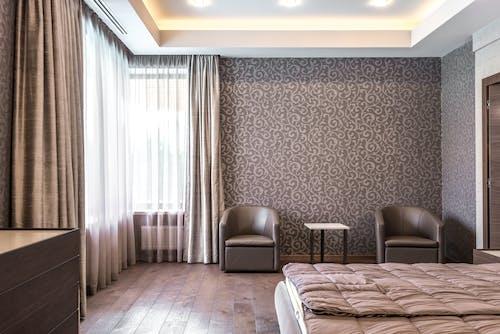 Bedroom with Wallpaper and Wooden Floor