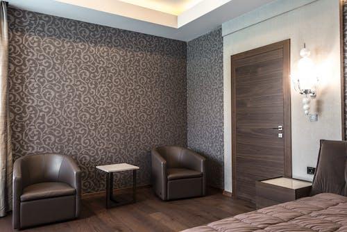 Brown Wooden Door Beside Light Fixture