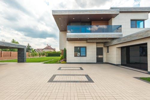 Kostnadsfri bild av arkitektur, betong, bilverkstad