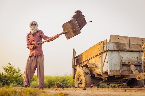 Безкоштовне стокове фото на тему «візок, ґрунт, копати»