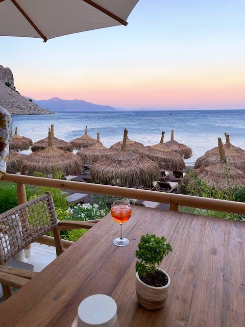 Foto profissional grátis de à beira-mar, ao ar livre, aperitivo