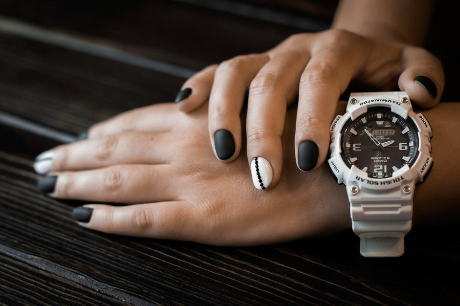 Person Wearing White Sports Watch