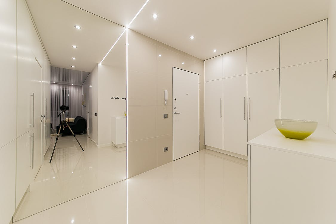 White Wooden Cabinet Beside White Wooden Door