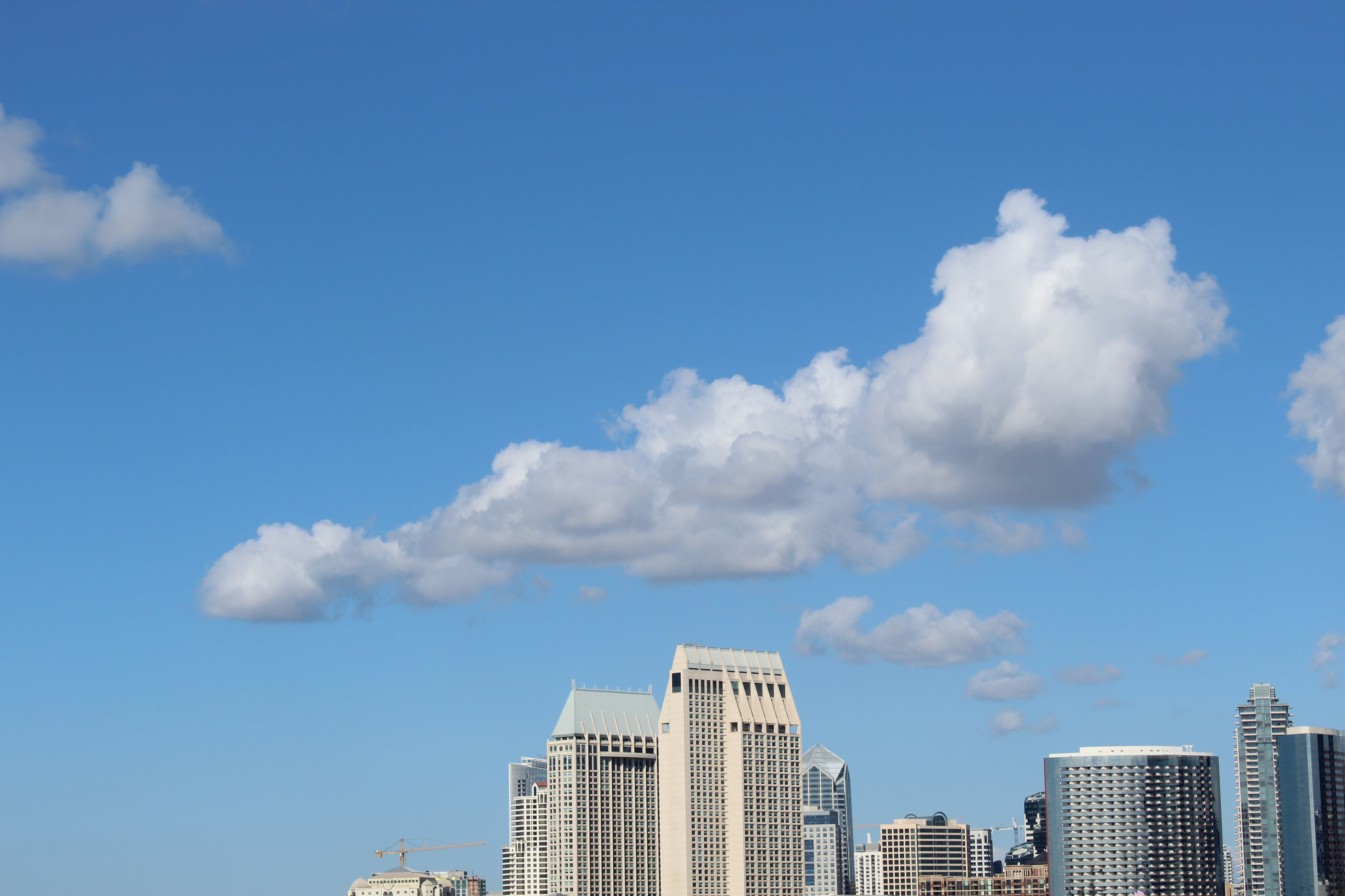 Cumulus Clouds Above High-rise Building