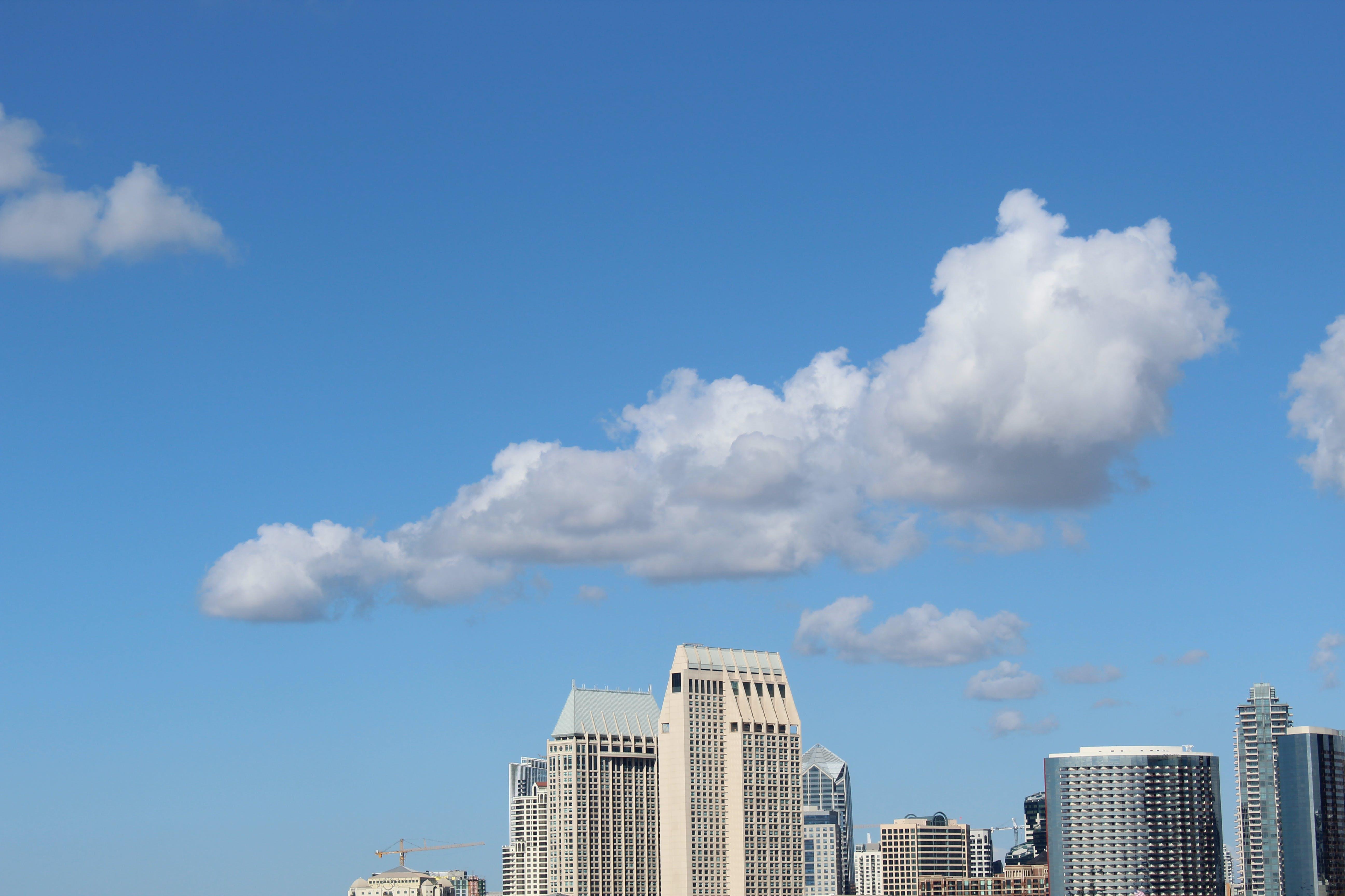 Cumulus Clouds Above High-rise Building