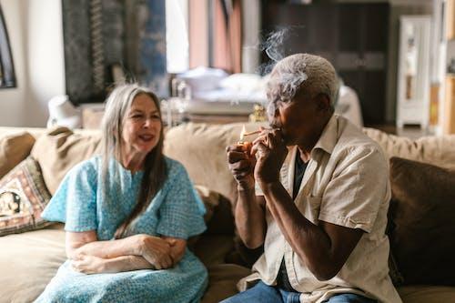Elderly Man Lighting Up a Joint