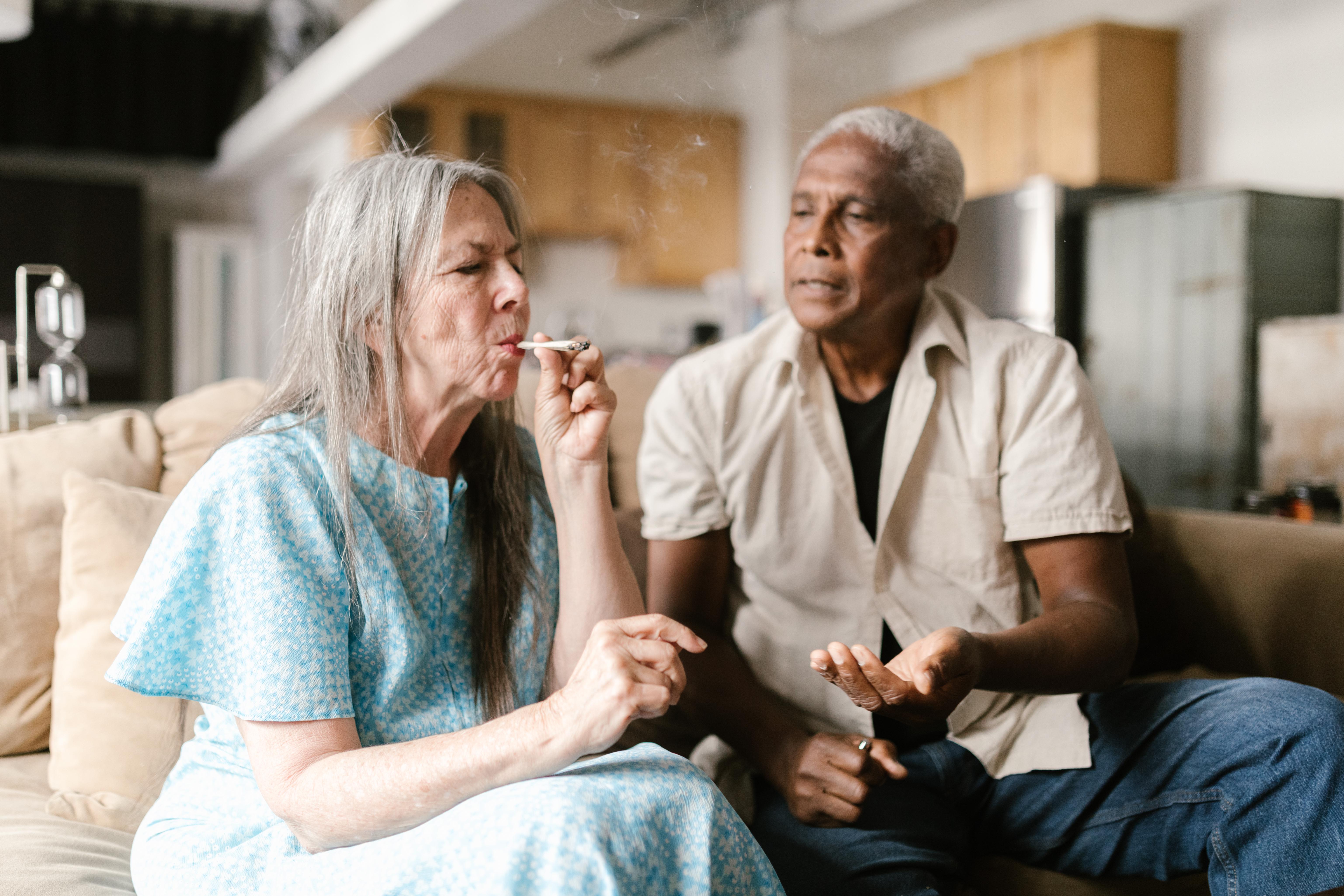 an elderly woman smoking a joint