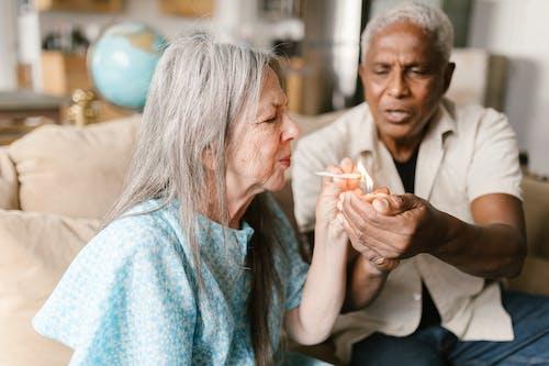 Elderly Woman Lights Up a Joint
