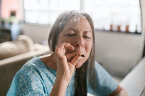Elderly Woman Smoking Blunt