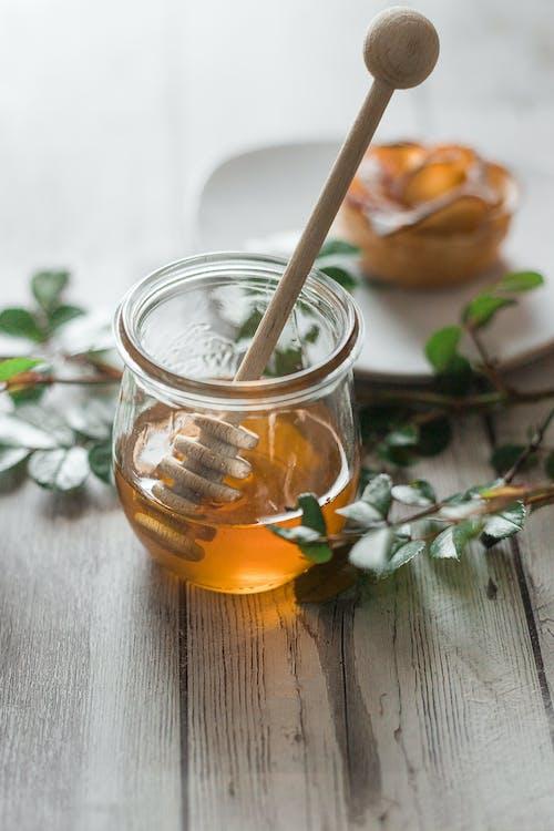 Clear Glass Jar With Orange Liquid