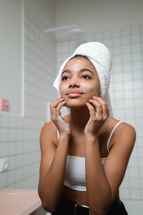 Woman Washing Her Face With Soap