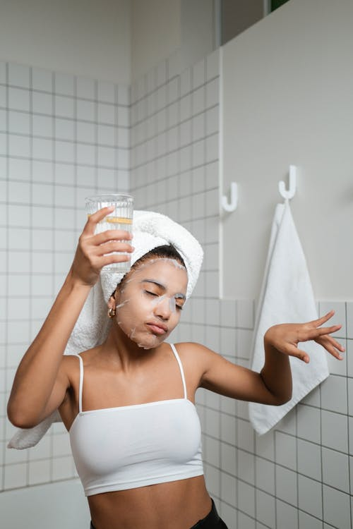 Woman Dancing In The Bathroom With Glass Of Water