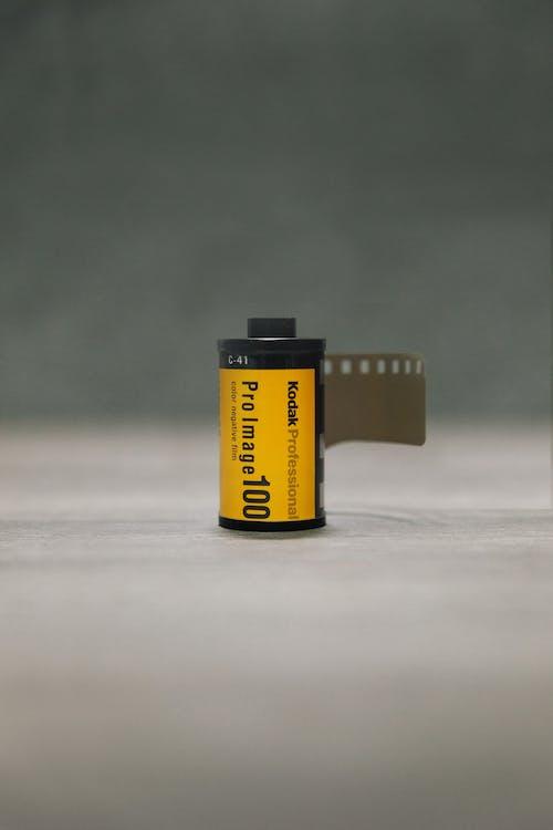 Yellow and Black Plastic Bottle
