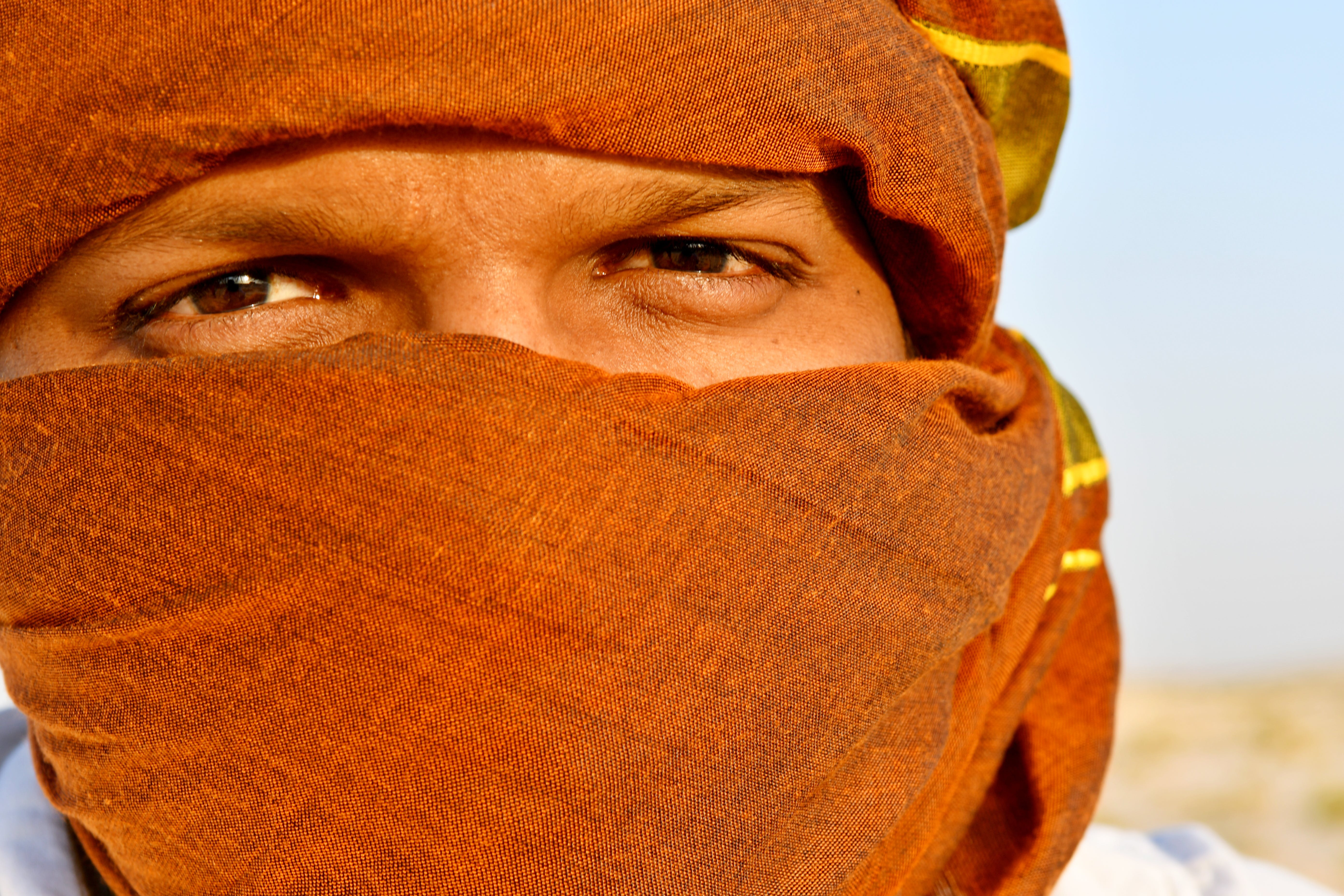 Man Cover Face Using Scarf