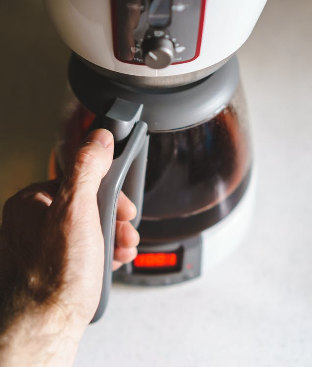 Free stock photo of coffee, hand, pot