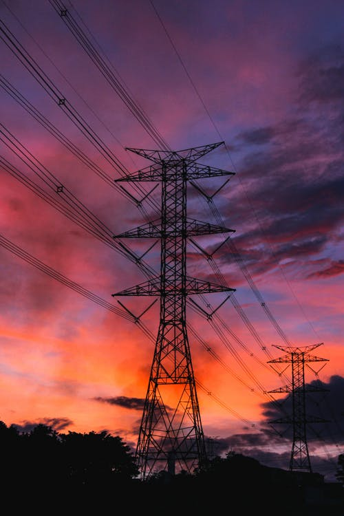 Black Electric Tower Under Blue Sky