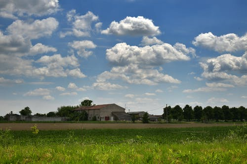 Free stock photo of clouds, countryside, farm fields