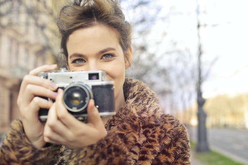 Woman Holding Black and Gray Camera Focus Photo