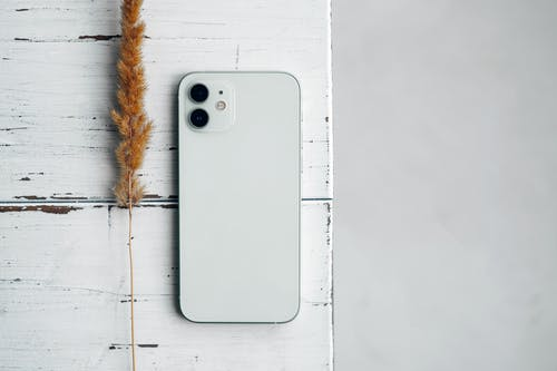 White Iphone 5 C on White Surface