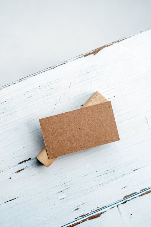 Brown Cardboard Box on White Wooden Table