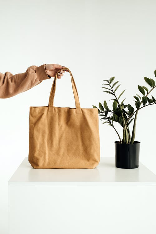 Brown Tote Bag on White Table