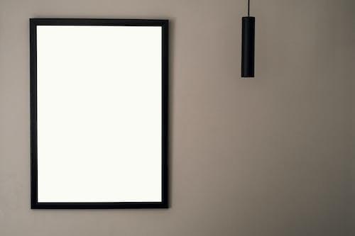 Black Framed Whiteboard Mounted on White Wall