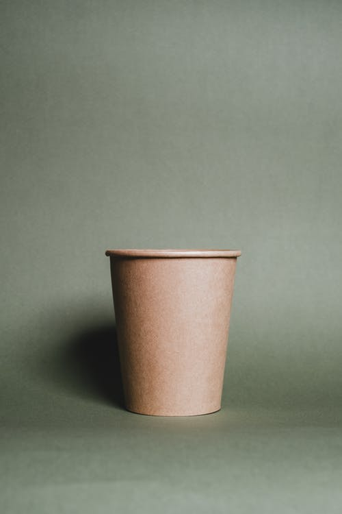 Brown Plastic Cup on Green Table