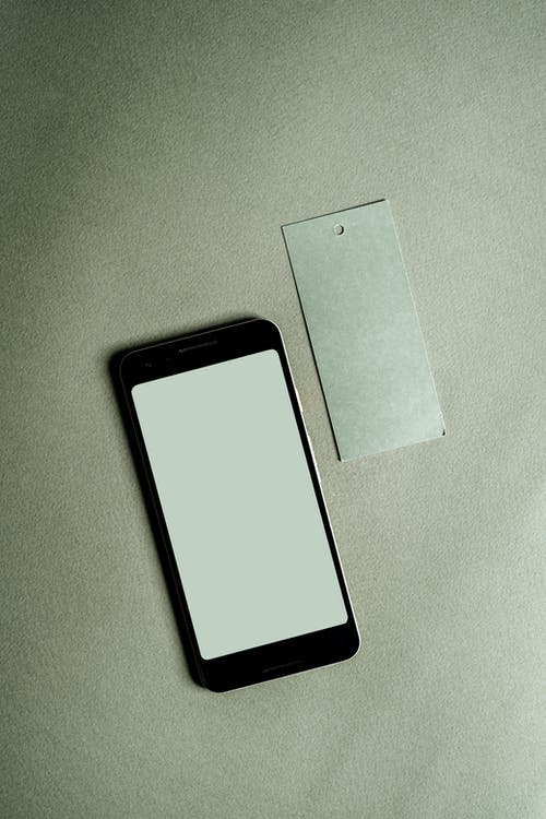 Black Android Smartphone on White Textile