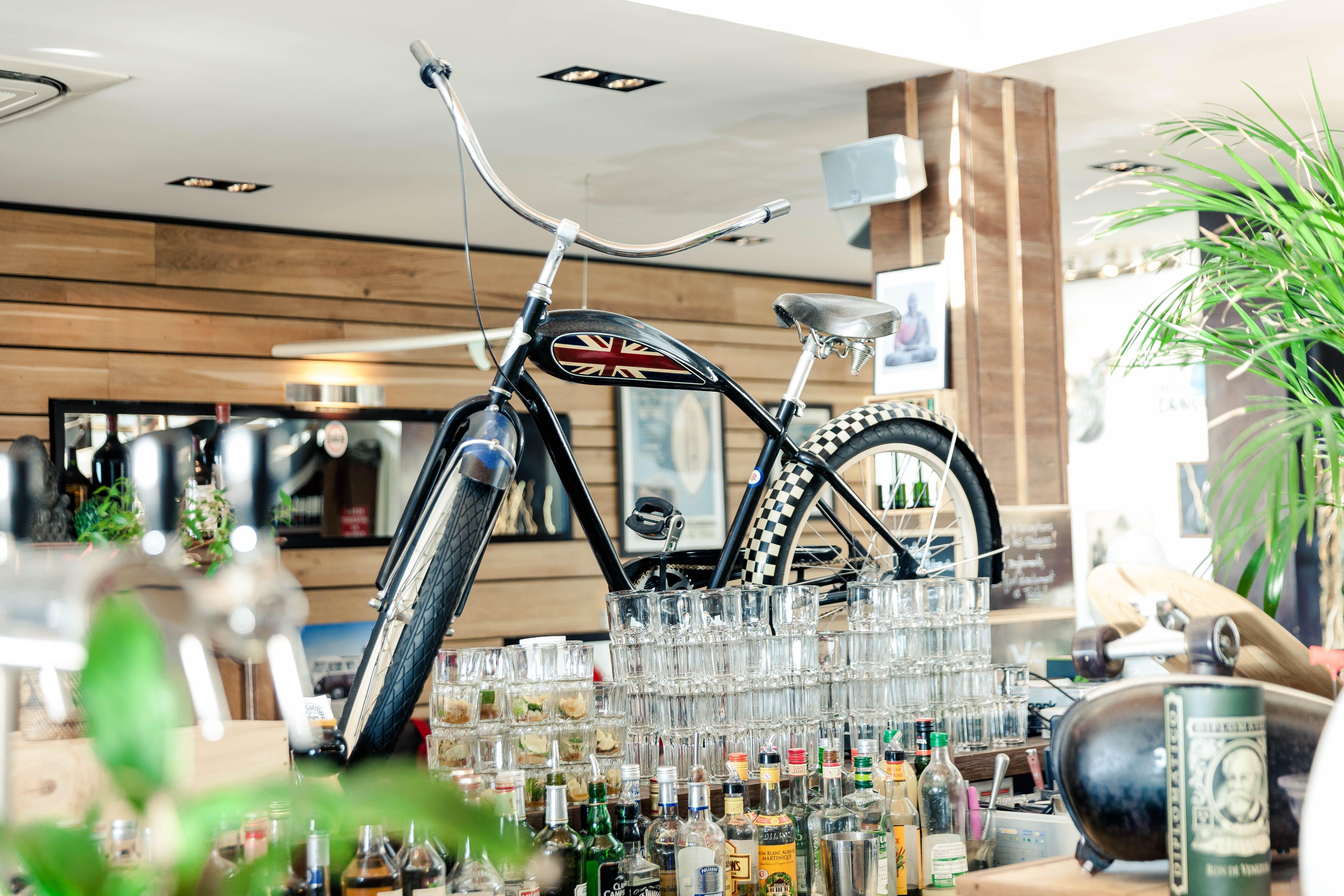 Black Cruiser Bicycle on Bar Table