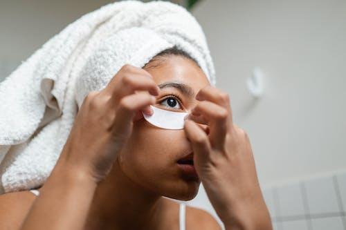 Woman Putting An Under Eye Mask