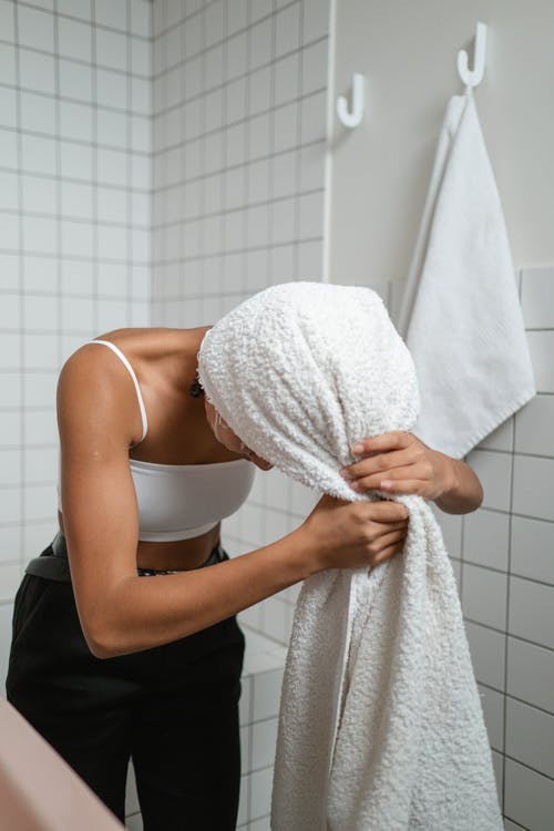 Woman Wrapping Her Hair With Bath Towel