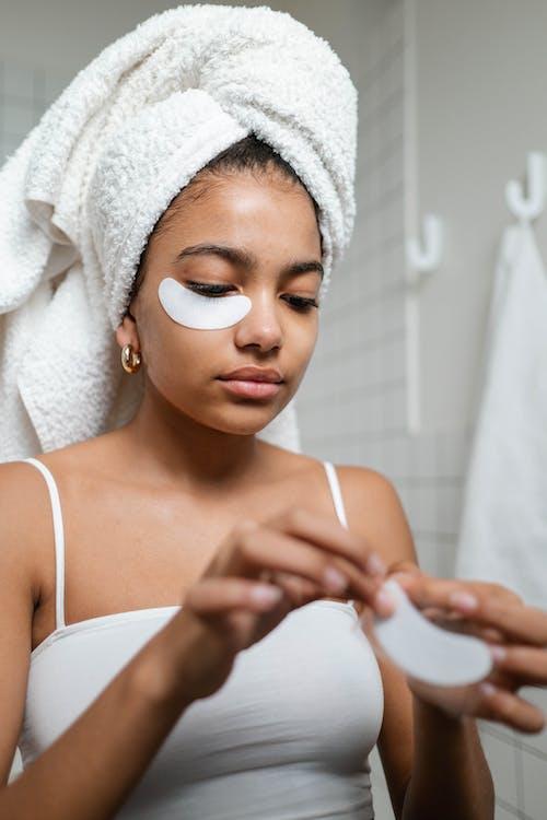 Woman in White Tank Top Putting Under Eye Masks