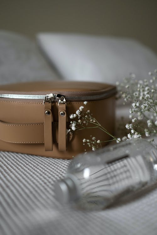 Brown Leather Sling Bag on White Textile