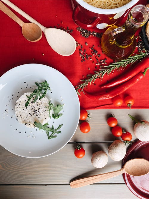 White Ceramic Round Plate With Green Vegetable and Red Chili