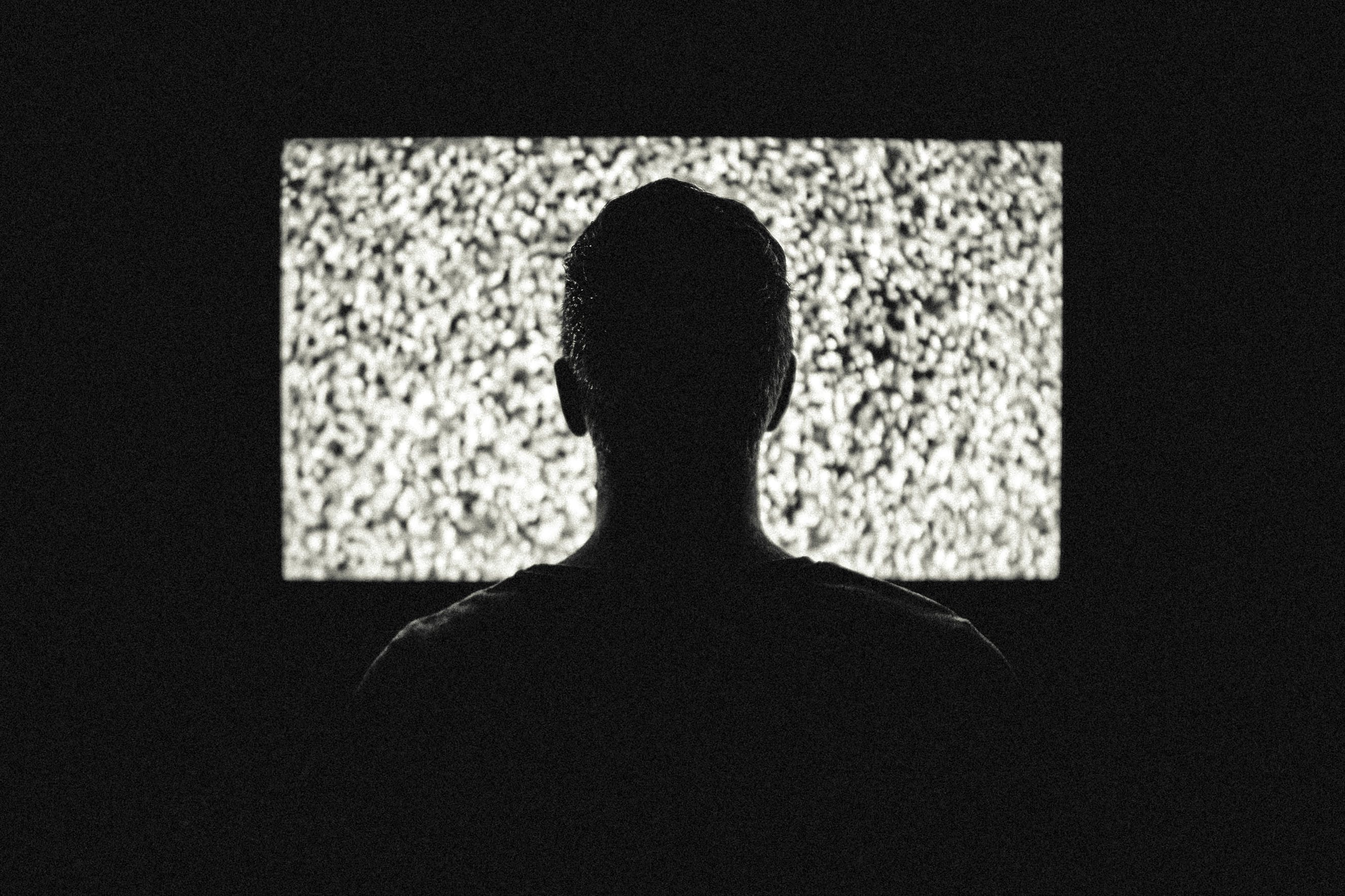 Silhouette of Man in Front of Tv