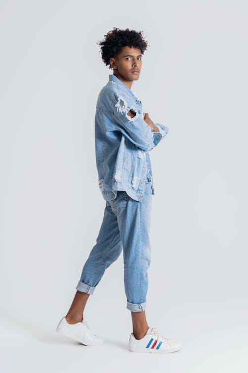Woman in Blue Denim Jacket and Blue Denim Jeans