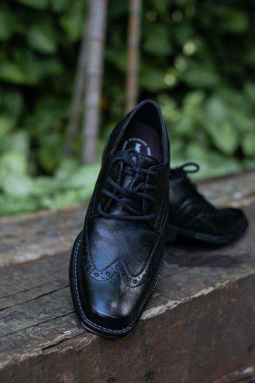 Black Leather Dress Shoe on Brown Brick Floor