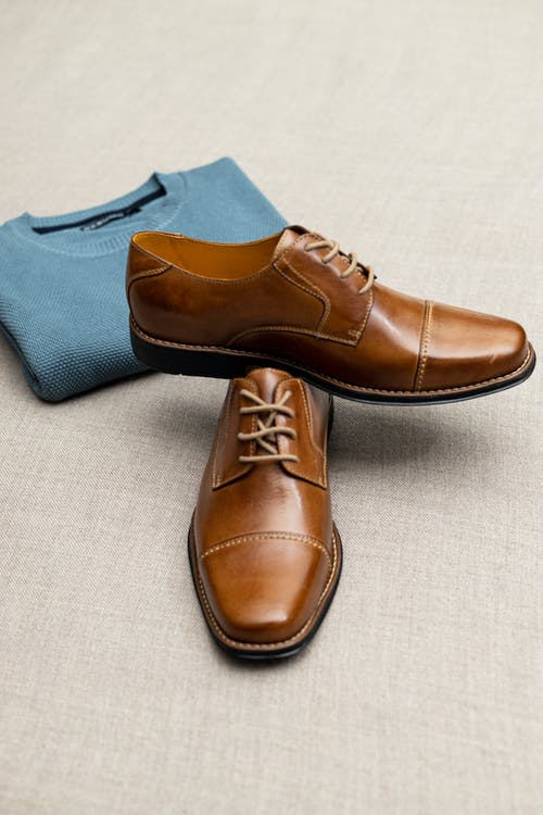 Brown Leather Shoes on White Textile