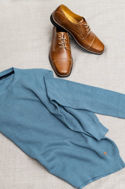 Blue Textile Beside Brown Leather Shoes