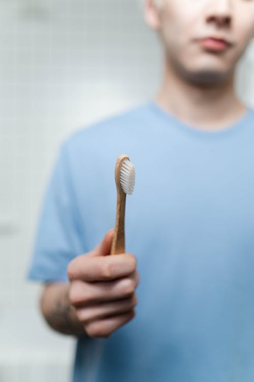 Crop Photo Of Man Holding A Toothbrush