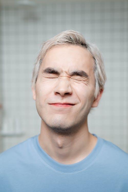 Man in Blue Crew Neck Shirt Wearing Eyeglasses